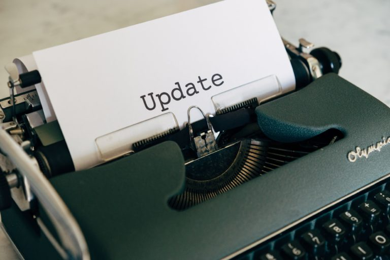 Typewriter with the word update